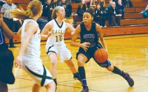 Carman-Ainsworth's Sydnee McDonald drives against two Lapeer East defenders in Monday's district opener at Lapeer West.
