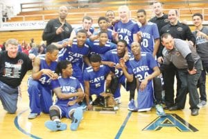 The Carman-Ainsworth boys' basketball team shows off its Class A district trophy last Friday.