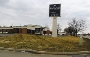 Left, Talmer Bank's distinctive black signs have replaced the old red and white ones at the former First Place Bank on Miller Road.