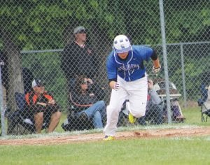 Carman-Ainsworth's Colin Heaton runs to first base during a game against Flushing in the 2012 season.