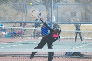 Carman-Ainsworth's No. 1 Singles player J'lynn Corder serves.