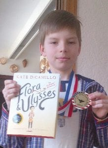 Alex Wickham, of Carman- Ainsworth's Randels Elementary, shows his medal for winning the fourth-grade level GISD spelling bee.