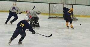 Cavs netminder Matt Weder (#1) gets caught out of position by Lapeer West last Friday at the Polar Palace in Lapeer.