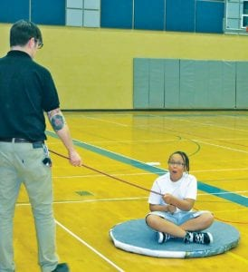 YouthQuest participants at Carman-Ainsworth Middle School each had a turn riding a homemade hovercraft during a visit from the Michigan Science Center traveling program.