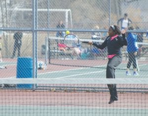 Carman-Ainsworth's J'Lynn Corder returns a forehand at No. 1 Singles.