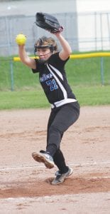 Madison Cox goes into her delivery at Powers Catholic last Friday.