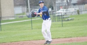 Chris Smith makes the throw for the Carman-Ainsworth varsity baseball team.