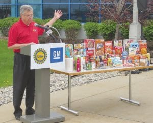 Larry Zahner, General Motors manufacturing manager, announcing that the UAW-GM team at Flint Assembly, Engine and Metal Center raised $24,290 for the Food Bank of Eastern Michigan.