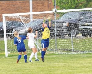 Carman-Ainsworth's Rachel Roop makes a save against Swartz Creek in the district opener on Tuesday.