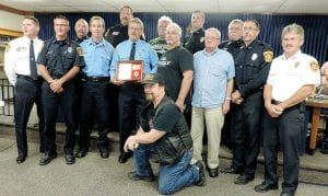 Several current and retired township firefighters attended a send-off for Lt. Robert Lloyd, who is retiring after 38 years. Top, a special cake was served in honor of Lt. Lloyd's retirement.