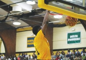 Carman-Ainsworth's Justice Green dunks the ball during the Bruin Classic last Thursday.