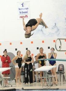 Carman-Ainsworth's Katelyn Niezgucki rotates through a dive at the annual Genesee County Meet at Fenton