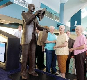 Descendants of Charles W. Nash look over the newly unveiled statue of their famous ancestor at a bronzed statue installation at Bishop Airport. The unveiling of the Charles W. Nash bronze statue at Bishop Airport also provided an opportunity to see up close up a 1929 Nash Advanced Coupe from Waterford and a 1948 four-door Ambassador for Orchard Lake, drove in by members of the Erie Shores Nash Club.
