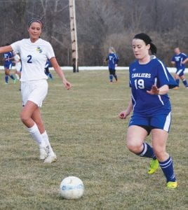 Alexis Thurber dribbles up field for Carman-Ainswoth. The Senior made first team All- Valley for the Cavs.