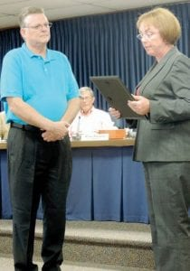 Township Supervisor presented a proclamation honoring former trustee James Huffman to his son David Huffman.