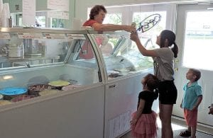 Beth Rogler scooped up ice cream for neighboring children who stopped in for a cool treat on a hot day at her new ice cream shop on Lennon Road.