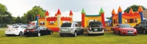 Bounce houses for the kids presented a colorful backdrop to Mid-East Festival activities.