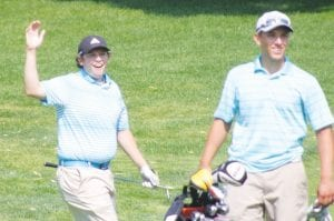 Fliushing's Joe Montpas (left) celebrates an eagle on the 16th hole while Justin Collick looks on in Monday's Mallon Cup Challenge at Flint Golf Club.