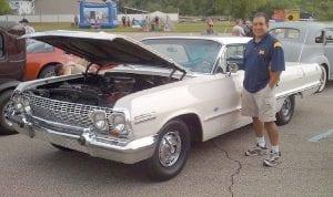 Dr. Benjamin Ramirez, a local pediatrician, shows off his '65 Thunderbird at a previous West Flint Car Cruise & Family Fun Festival.
