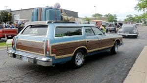 How's this for a trip down memory lane? This 1960s-era station wagon was loaded with luggage reminiscent of family vacations. At right, tin cans like this one aren't something you spot on the road every day.