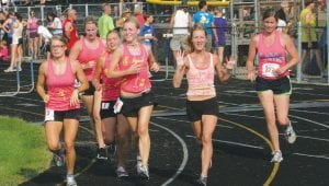 The core five friends of Kaitlin and Kayla O'Mara ran the final lap inside the Goodrich stadium in the 2011 race. Left to right: Kelsey Krych, Kelsey Meyers, Kaitlin O'Mara, Danielle Bila, Janee Jones, Sam Minkler.