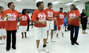 Carman-Ainsworth senior center members wearing their bright red logo T-shirts join others on the dance floor for a fun line dancing class every Thursday evening.