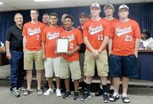Business owner Roger Foutch, coaches and players for Foutch's Strike Zone baseball team received a proclamation from the township board in recognition of a very successful season.