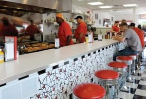 Patrons cozy up to the counter inside the newly opened Vehicle City Classic Diner.