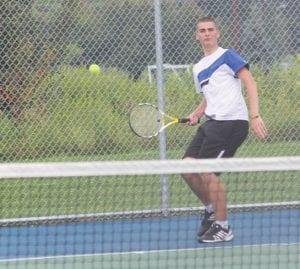 Carman-Ainsworth No. 1 Singles player and co-captain Damon Haley.