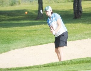 Carman-Ainsworth's Sloan Barclay chips out of the bunker.