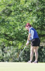 Carman-Ainsworth's Madysen League putts during the Genesee County Meet at the Davison Country Club on Monday.