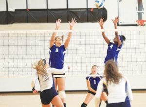Carman-Ainsworth's Korbin Brandon (9) and Sydney Cunningham (4) go up for the block.