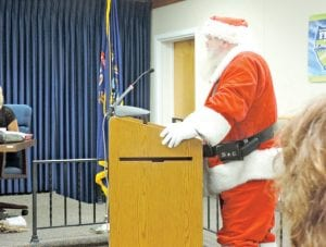 Among several pro and cons speakers at the township's Aug. 11 meeting, regarding street soliciting, was this man dressed as Santa Claus, who spoke against the ordinance and in support of the Old Newsboys annual street drive to raise funds to provide Christmas gifts for disadvantaged children.