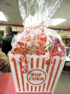 "The Flint Township Board donated this ""movie night"" gift basket. Several other gift baskets, including one containing gift cards to area businesses, will be given away in a door prize drawing during the annual Pig Roast at the senior citizens center."