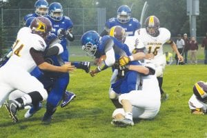 Carman-Ainsworth's Caleb Ruffin (3) fights for extra yardage in last Friday's game against Davison. Ruffin led the Cavs with 98 yards on 15 carries.