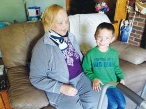 Jackson Schultz, age 5, a C-A kindergartner, cuddles with his grandmother, Margaret Jabs who is recovering from a rollover automobile accident in mid-August that they both survived.