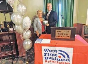 WFBA president Debbe Campbell congratulates Don McGrain, recipient of the annual WFBA Don Eve Achievement Award.