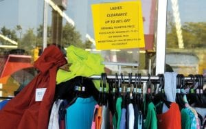 A sandwich board sign on Miller Road and sidewalk sale merchandise alert the public that a liquidation sale has begun at the long-standing Kmart store on Miller Road.