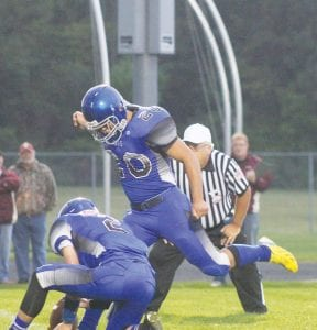 Carman-Ainsworth's Ahmad Alzahabi kicked six extra points for the Cavaliers in last Friday's win.