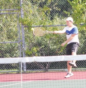 No. 2 Singles player Vlad Li is one of six Carman-Ainsworth seniors who played their last high school match last Thursday in the regional tournament.