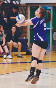Carman-Ainsworth's Korbin Brandon puts all her energy into a dig.