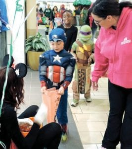 Trick or Treating started at the Genesee District Library in the Sears wing and made its way around the mall during the annual four-hour children's Halloween bash on Saturday at Genesee Valley Center shopping mall.