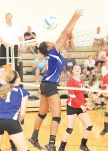 The Cavaliers' Deja Lester tries for a stuff during a recent match