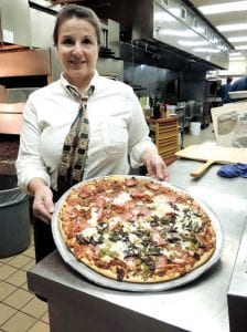 Susan Vallecorsa with one of Ruggero's prize-winning pizza fresh from the stone block oven.