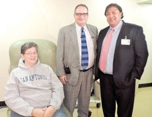 Cynthia Suter of Lapeer with two of her doctors, cardiothoracic surgeons Sanjay Batra and James Martin, talk about her operation and recovery during a press conference at McLaren Flint last week.
