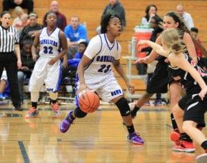 Natalia Kincaid brings the ball up court.
