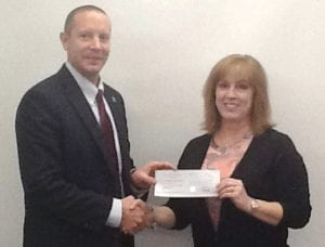 C-A Superintendent Steve Tunnicliff accepts STEM grant from The Grainger Foundation.