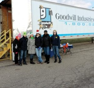 Goodwill parked a truck in front of Sam's Club to take in money, food and clothing donations.