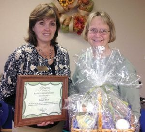 Max Well Therapy owner Jill Maxwell presents Denise Butts with a massage gift basket. Butts was chosen as the latest recipient of Max Well's Pay it Forward program.