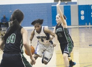 Carman-Ainsworth's Harmany Williams (5) had seven points and five steals in last Thursday's game.